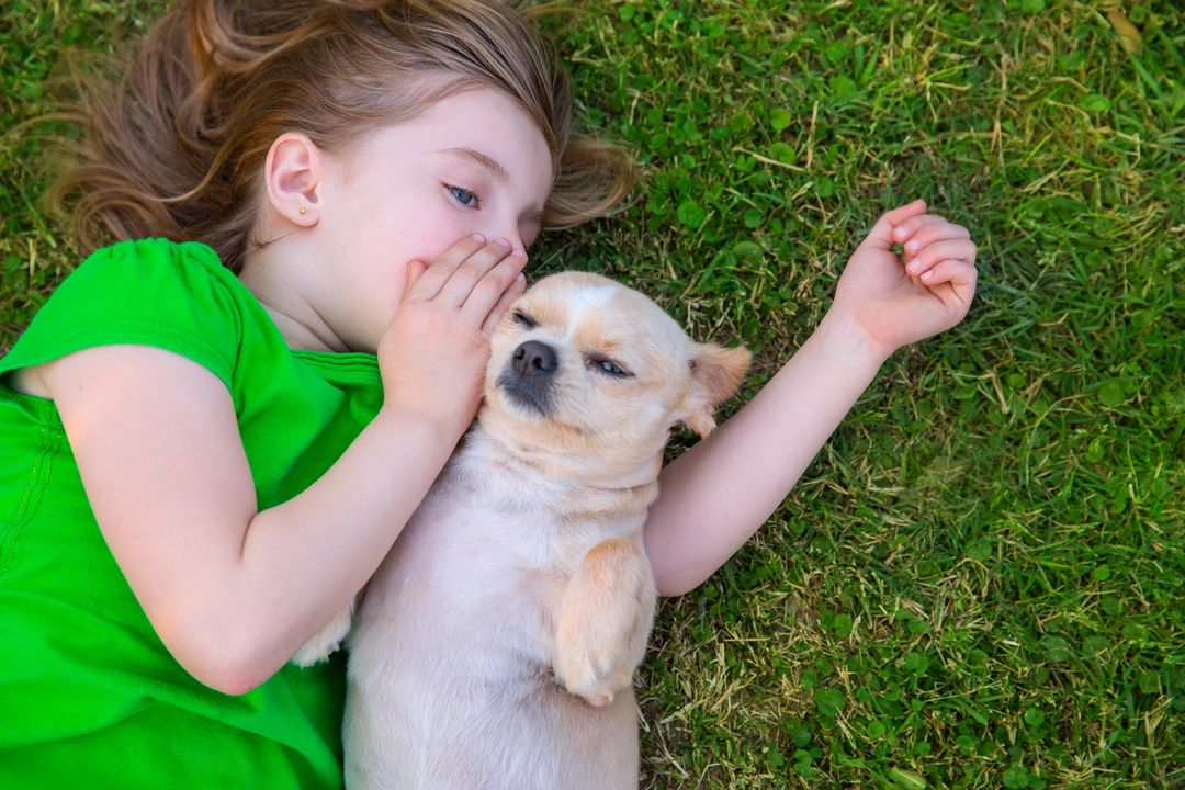 girl whispering to dog – Sioux County Community Health Partners
